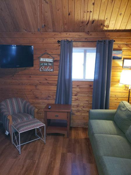 Alpine Hideaway Campground - Cabin 80 Sitting Room